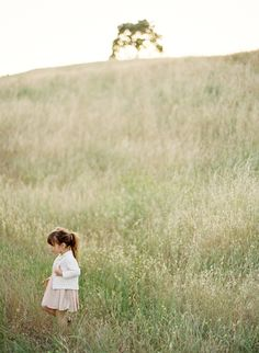 Summertime- little girl playing in the field | Photography: Jose Villa
