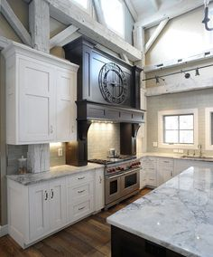 Timber Frame Barn Kitchen. Love the clock!