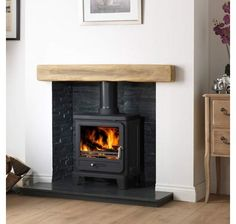The Helios 5 Cleanburn Wood Burning and Multi Fuel Stove is an addition to the Gallery range of stoves. The Gallery Helios 5 is a wood burning stove that is Defra approved, so can be used in smoke controlled areas. Wood Burner Fireplace, Inglenook Fireplace, Fireplace Hearth, Home Fireplace, Fireplace Design, Fireplaces, Fireplace Inserts, Fireplace Ideas, Mantle