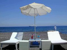 The Hotel Mediterranean White Hotel is a boutique 4 star Hotel located in Ag.Paraskevi-Kamari, in a distance of 150 meters from the famous Black Beach of Santorini. Kamari Beach, Places In Greece, Hotel Services, Famous Black, Beautiful Islands, Santorini, Patio, Vacation, Luxury