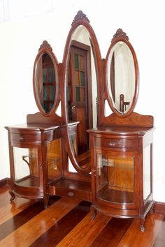 Oversized tres lunas tocador with curved glass front, from the collection of Aureo Alonzo, Malate, Manila, early 1900s, narra