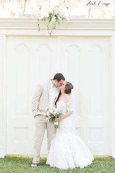 Outdoor wedding with huge church doors.  Southern wedding Amy & Mike's backyard wedding. Lazaro ruffled wedding gown.  http://amalieorrangephotographyblog.com/2014/11/16/amy-mikes-sneak-peek-lakeside-estate-wedding-orlando/