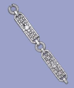 A FINE ART DECO DIAMOND BRACELET, BY LACLOCHE FRERES. Designed as two baguette and circular-cut diamond openwork panels with square-cut diamond centre to the pavé-set buckle links and baguette-cut spacers (three stones deficient), circa 1925, 18.6 cm. long, with French assay mark for gold Signed Lacloche Fes., no.73239
