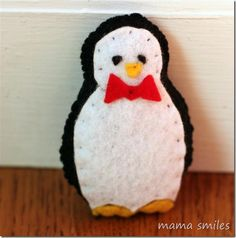 Penguin Stuffie from Craft-A-Day by Sarah Goldschadt - a book full of fun, creative crafts that are easily made using paper and felt!