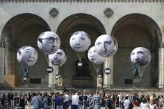 Balloons depicting the faces of leaders participating in the summit meeting of the Group of 7 in Munich. From left, the balloons show Prime Minister Shinzo Abe of Japan, President Francois Hollande of France, Prime Minister Matteo Renzi of Italy, Chancellor Angela Merkel of Germany, Prime Minister Stephen Harper of Canada, Prime Minister David Cameron of Britain and President Obama.