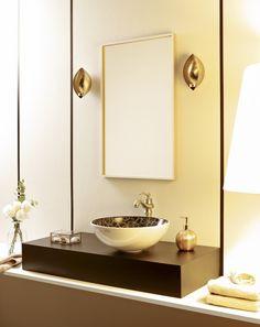 Cuarto de baño en tonos dorados