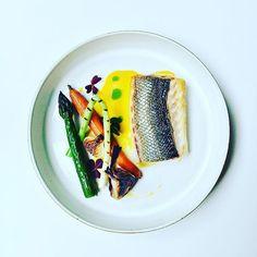 Sea bream filet with carrot/orange sauce and seasonal veggies