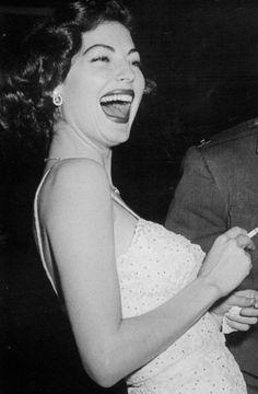 Ava Gardner, laughing.