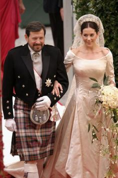 Miss Mary Elizabeth Donaldson walk down the isle with her father Dr. John Donaldson moments before marrying Crown Prince Frederik at the Copenhagen Cathedral 14 May 2004 in Copenhagen, Denmark.
