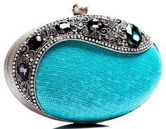 Rosamaria G Frangini | High Clutches | Turquoise Blue Minaudière. Oval clutch with stones and silver