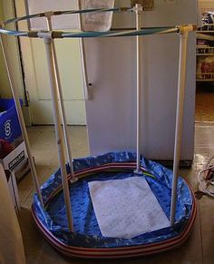 homemade portable shower made with PVC pipe, 2 hula hoops, and an inflatable pool - Outreach Therapy Consultants