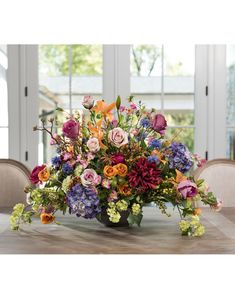 Weave a bold tapestry of color as the centerpiece of your grand space with Grand Floral Tapestry silk flower arrangement from Petals.