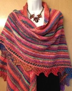 Big triangle shawl with lacy edge. Get free knitting pattern today!