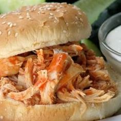 "Slow Cooker Buffalo Chicken Sandwiches - creator of this recipe said, ""This is a spicy, hearty sandwich that will please those who love buffalo chicken wings. This recipe is perfect for those days spent watching football. I like to top these with blue cheese or ranch dressing."""