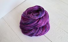 Yarn - 75% Superwash Merino 25% Nylon Weight - 100g, 4ply, Fingering Length - 400m Recommended Needle/Hook Size - 2.5mm-3.5mm Colourway - Royal purple with navy blue and magenta splashes