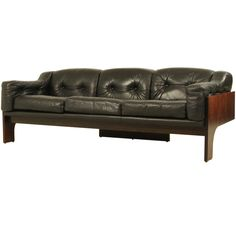 Claudio Salocchi 'Oriolo' sofa in rosewood and leather | From a unique collection of antique and modern sofas at https://www.1stdibs.com/furniture/seating/sofas/
