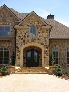 Love this rock and brick for the exterior  This IS what my future home exterior will be made from :)