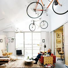 Don't forget the ceiling: Small-home living requires creative--sometimes even eccentric--storage solutions.