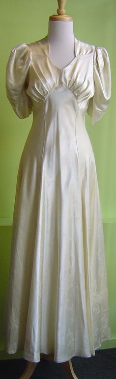 labeled puff sleeve but the sleeves and the bodice both look more like the to me. It could be from the late I suppose. 60s And 70s Fashion, 1930s Fashion, Timeless Fashion, Vintage Fashion, Vintage Clothing, Vintage Dresses, Vintage Outfits, Satin Dresses, Bridal Dresses