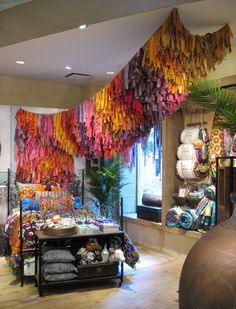 fabric installation at anthropology by Trilby Nelson- various materials on burlap netting
