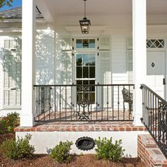 Brick porch floor with wood columns/New Orleans Charm with a Private Courtyard traditional porch Front Porch Railings, Brick Porch, Front Porch Design, Porch Columns, Front Porches, Wrought Iron Porch Railings, Metal Balusters, Porch Windows, Wood Columns