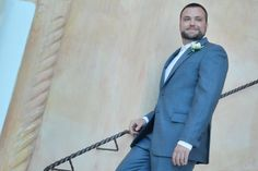 Handsome groom Leif in a Joseph Abboud suit