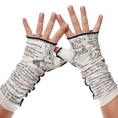 """Can't take your hands off of your favorite book? Now you'll never have to! Let everyone know about your great taste in books by adorning your wrists in the words of your favorite author. These gloves will keep you looking & feeling both warm & intelligent. Each pair is created from American-made, super soft 100% cotton knit fabric. The open palm circumference is about 8"""" and the arm band is about 7"""" around. The inseam has a decorative serged detail created from a contrasting, silky stretch…"""