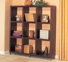 3 x 3 Bookcase $449.00 DESCRIPTION A quick and simple solution to dress up a wall or use it as a room divider. This functional wall unit is on six casters for mobility. Comes in a warm mahogany finish. Simple camlock assembly. #ricksfurniture