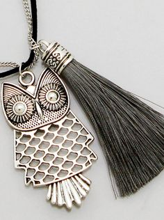 """Silver Owl and Black Suede Tassel Necklace Burnished silver cut out owl on a silver chain and black cord with black suede tassel. Necklace measures 34"""" plus 2"""