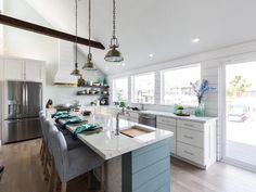 white and blue beach house kitchen