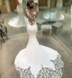 This pretty wedding gown has a sheer lace back. The train has nice lace insets as well. We can make sexy #weddingdresses like this with any customization. If your dream dress is out of your price range we can also make #replicas of couture designs from a picture. Our version will have teh same style & look but cost way less than a couture designer dress. Find out how and get pricing when you email us directly. DariusCordell.com