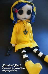 Coraline rag doll, with plenty of buttons and blue hair.