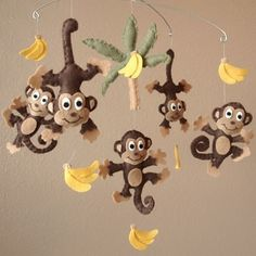 Baby monkeys bananas and a palm tree make an adorable mobile for a baby for this nursery http://bit.ly/bxfFQG
