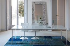 Slim glass dining table