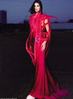 Red makes a statement: Kendall looked sporty in this silk down with plastic covering... #kendalljenner