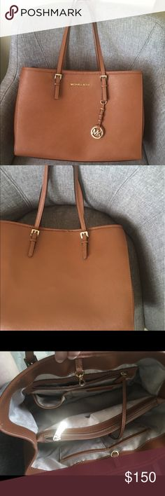 "Michael Kors Large Jet Set Saffiano Michael kors jet set travel large east west tote.                            Condition: There are scuffs on the protection feet. I'll include a MK leather cleanser which removes all stains. Please see the last pictures. All of my items come from pet free and smoke free environment Material : Saffiano Leather Color : Brown Bag Height :	10"" Bag Depth :	5"" Bag Length :	14"" Strap Drop :	9.5"" MICHAEL Michael Kors Bags"