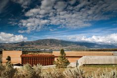 Built by DIALOG in Osoyoos, Canada with date 2006. Images by Nic Lehoux Photography. The Nk'Mip Desert Cultural Centre is designed to be a specific and sustainable response to the building's unique cont...