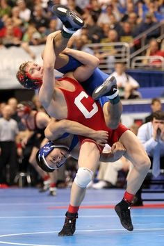 PHILADELPHIA, PA - MARCH 18: Kyle Dake of Cornell University lifts Ganbayar Sanjaa of American University during their 149 pound semi-final match during the NCAA Wrestling Championships on March 18, 2011 at the Wells Fargo Center in Philadelphia, Pennsylvania.