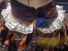 @: necktie ruffle bustle