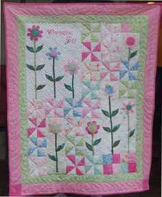 This is the quilt I was working on using the pinwheels  and the applique flowers . It's now all put together, quilted and bound.         ...