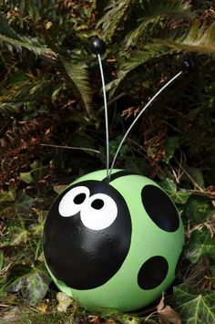 Reuse a BOWLING Ball?  Yes!  It makes a cute garden bug.  From TwoWomenandAHoe.com