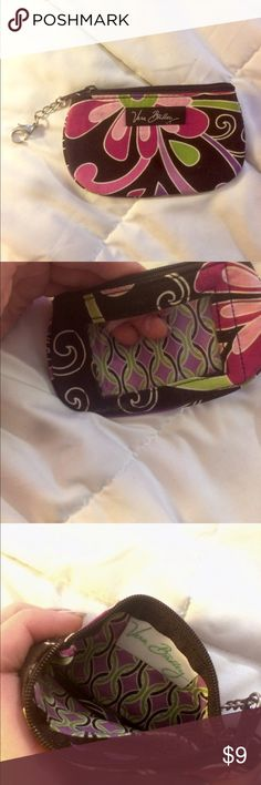 Vera Bradley Coin Pouch Super cute and In great condition. Perfect to grab on the go when you only need a little bit of cash and a card or two. Has a chain to attach to purse or a bigger wallet when needed.   *my house is not smoke free, therefore my items may smell like smoke* Vera Bradley Bags Wallets