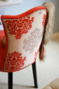 Coral damask fabric chair with nail head