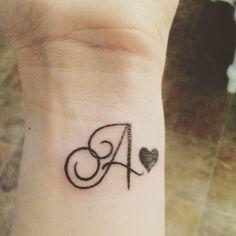 Tattoo of spouses initial Tattoo Alphabet, Alphabet Tattoo Designs, Tattoo Designs Wrist, Wrist Tattoos, Mini Tattoos, Finger Tattoos, Cute Tattoos, Body Art Tattoos, Small Tattoos