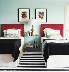 bedrooms - Pratt and Lambert - Lost Oasis - red upholstered headboard black white striped rug ikat turquoise blue red bolster pillow white hotel bedding black stitching black throw blankets art copper lamp brass glass top accent table turquoise blue walls
