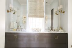 luv the fixtures and hardware....the window in the middle is a great detail to allow natural light by mirrors......Urban Grace Interiors