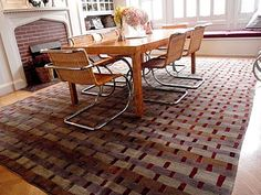 Rag Weave by designer Kevin Walz for Tufenkian is seen here in this transitional dining room.