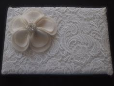 Guest Book Lace Ivory Silver Would probably take off the flower and have our date embroidered on it C3
