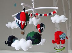 With MUSICAL CRIB ATTACHMENT. World travel themed red, blue and green hot air balloon, elephants and globe rotating musical mobile. by BabyBeansNZ on Etsy