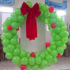 Giant Christmas Balloon Wreath - Creative ideas for Christmas Balloon Art! Fun DIY Holiday Decorations that turn your home or party into a festive winter wonderland.